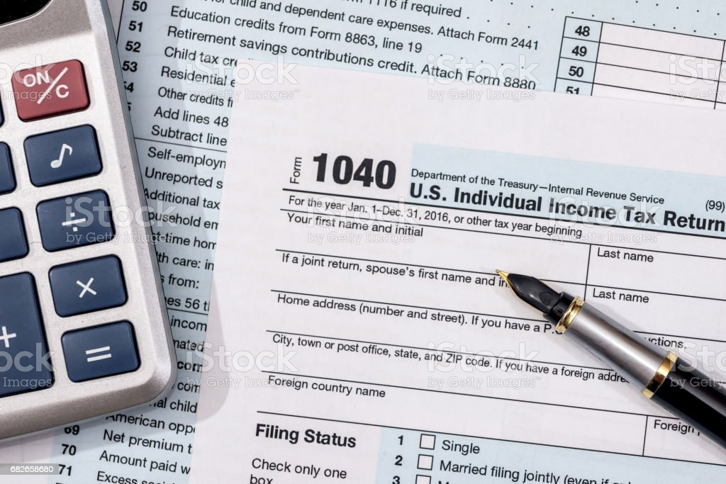 U.S. 1040 tax form with pen and calculator. stock photo