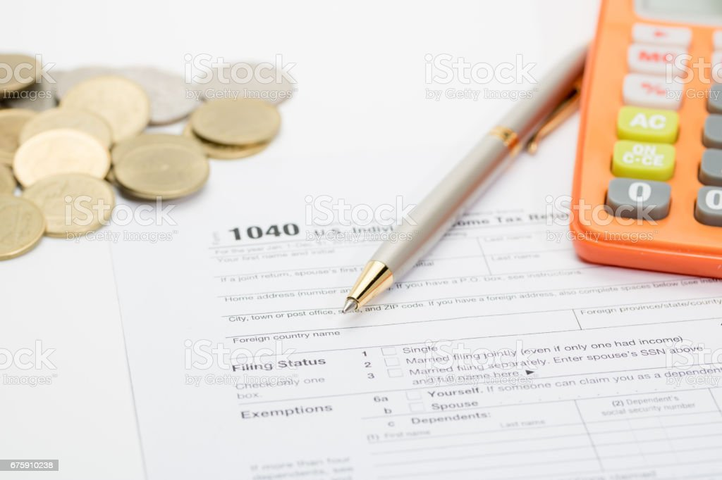 Us Tax Form With Pen And Coins Selective Focus Taxation