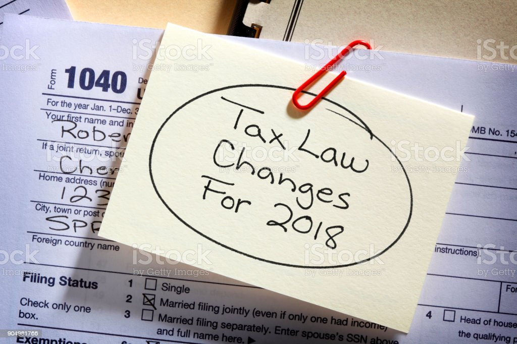 Tax Form With Reminder Of New Tax Laws Attached royalty-free stock photo