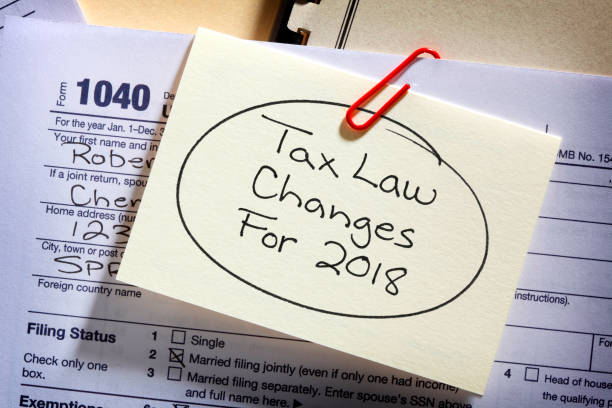 Tax Form With Reminder Of New Tax Laws Attached stock photo