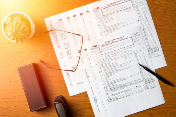 US tax forms 1040,1120,1065 on the table stock photo