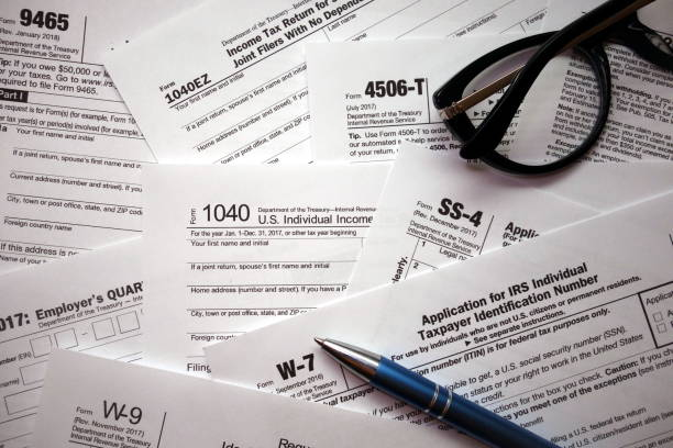 US tax forms background stock photo