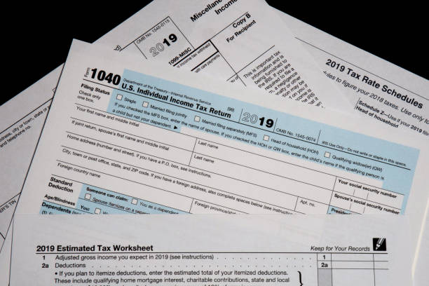 2019 US/IRS tax forms lay on a desktop 2019 US tax forms lay on a desktop in West Des Moines, Iowa. taxes stock pictures, royalty-free photos & images