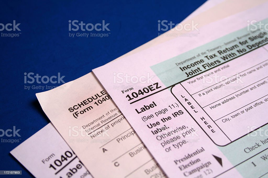 Tax forms on blue royalty-free stock photo