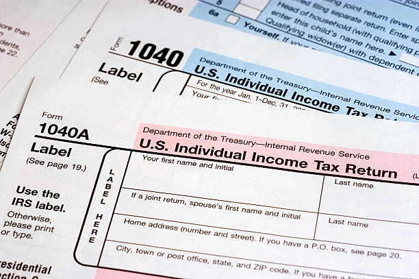 Tax Forms US 1040 tax forms 1040 tax form stock pictures, royalty-free photos & images