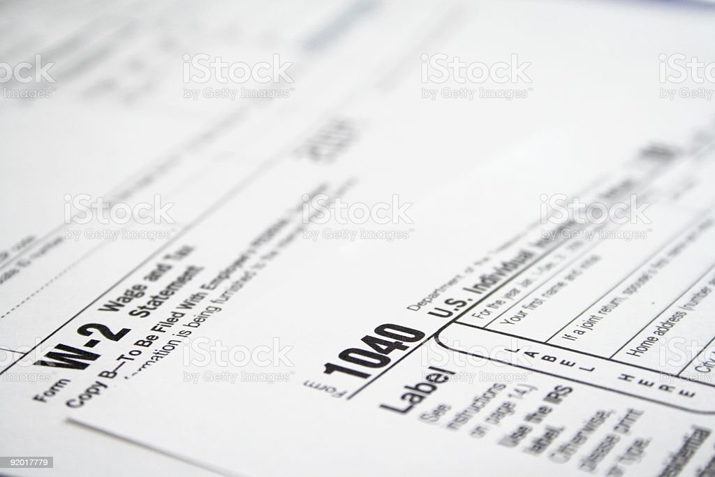 Tax Forms - W-2 and 1040 stock photo