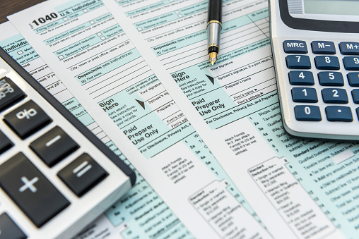 Tax Forms with Calculator and Pen. Financial accounting. Paperwork