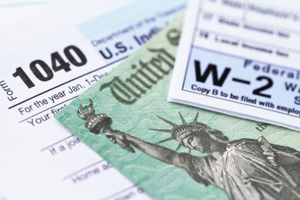 IRS tax forms with tax refund check stock photo