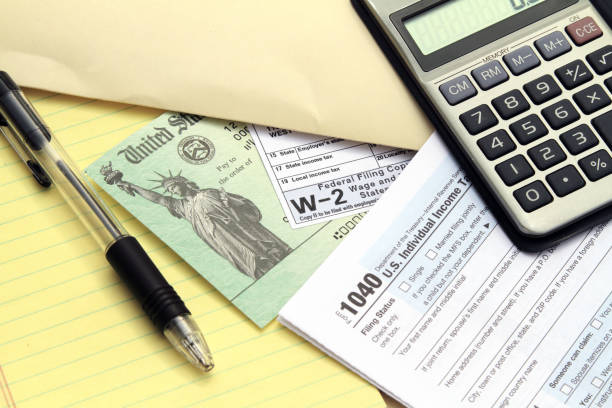 Tax forms with Treasury check and calculator stock photo