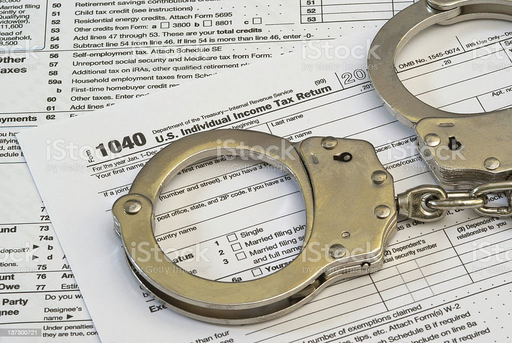 Tax Fraud or Slave to Taxes stock photo