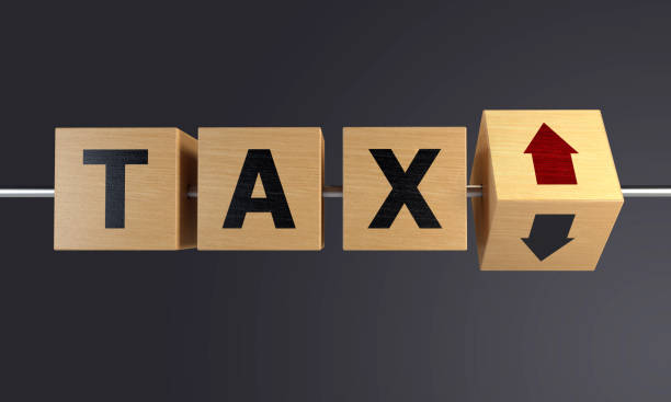 tax increase with wooden block - word game stock pictures, royalty-free photos & images