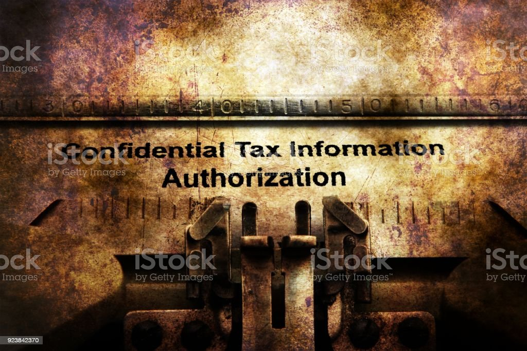 Tax information on vintage typewriter stock photo
