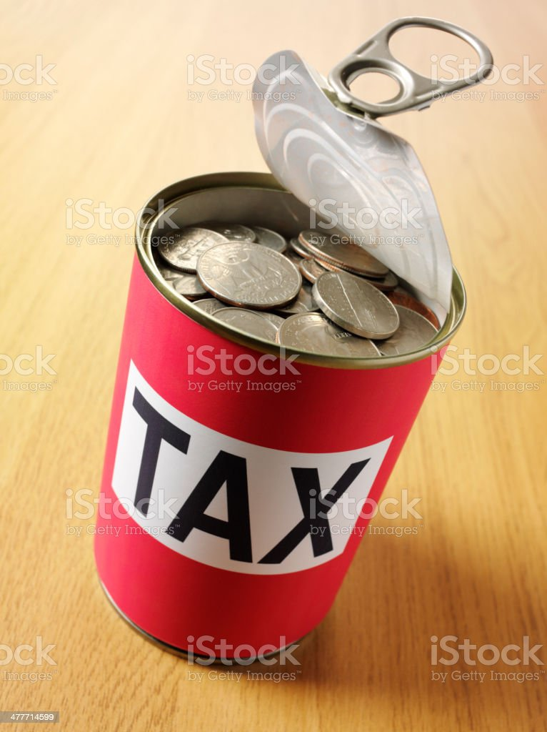 Tax Label on a Tin Can with American Currency royalty-free stock photo