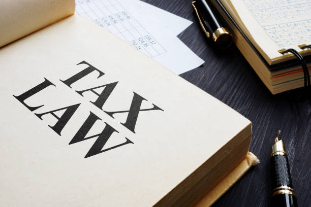 Tax law and accounting report on a table. stock photo