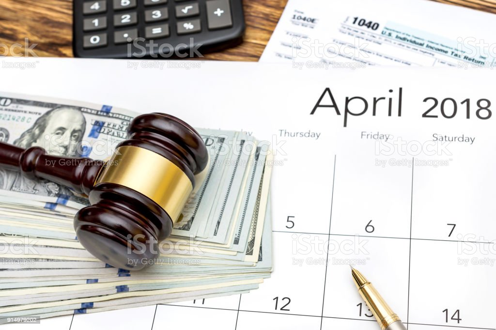 Tax law concept. Tax form with gavel, money and calendar on the table. Top view. stock photo