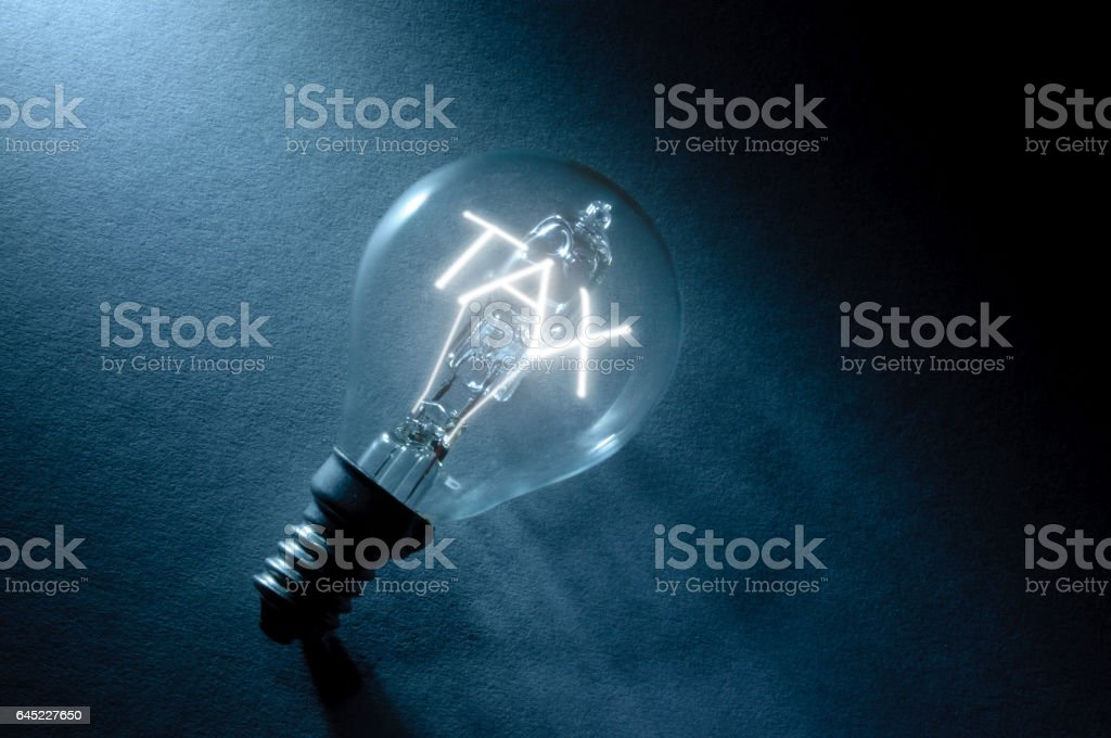 Tax light bulb stock photo