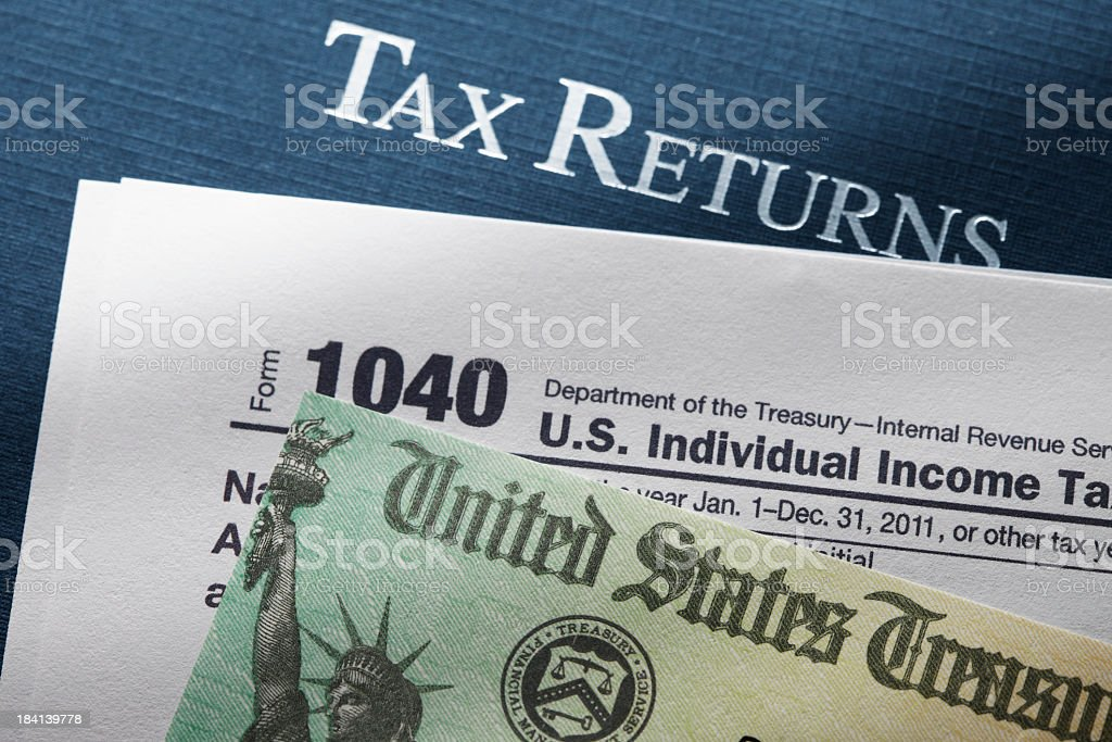 Tax refund check on IRS 1040 tax form royalty-free stock photo