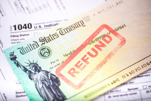 A United States treasury check with a tax refund