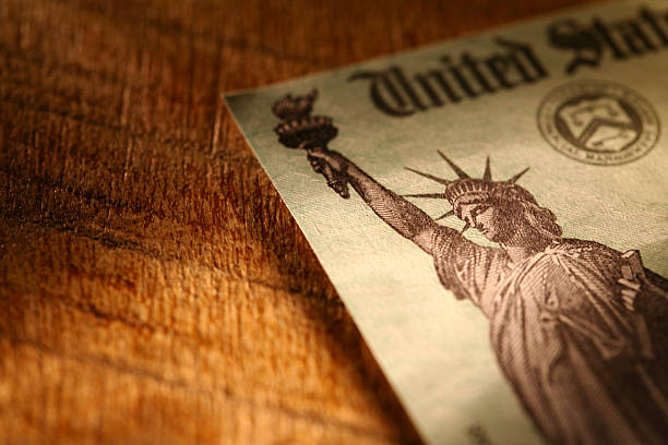 tax refund check - social security check stock photos and pictures