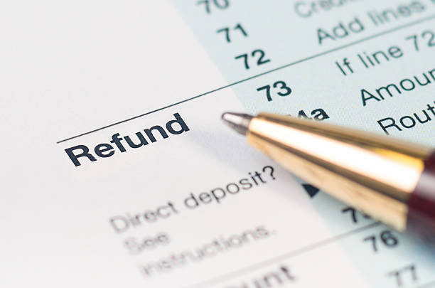Tax refund form closeup Close-up of Refund on a tax return form with a pen. refund stock pictures, royalty-free photos & images