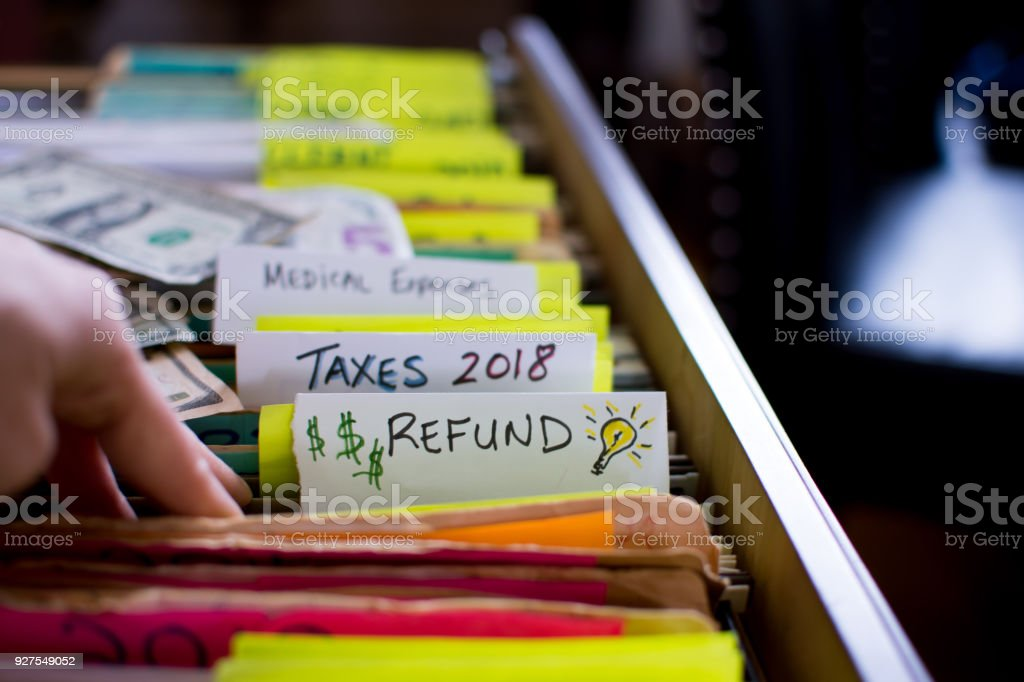 Tax refund ideas and tax return preparation stock photo