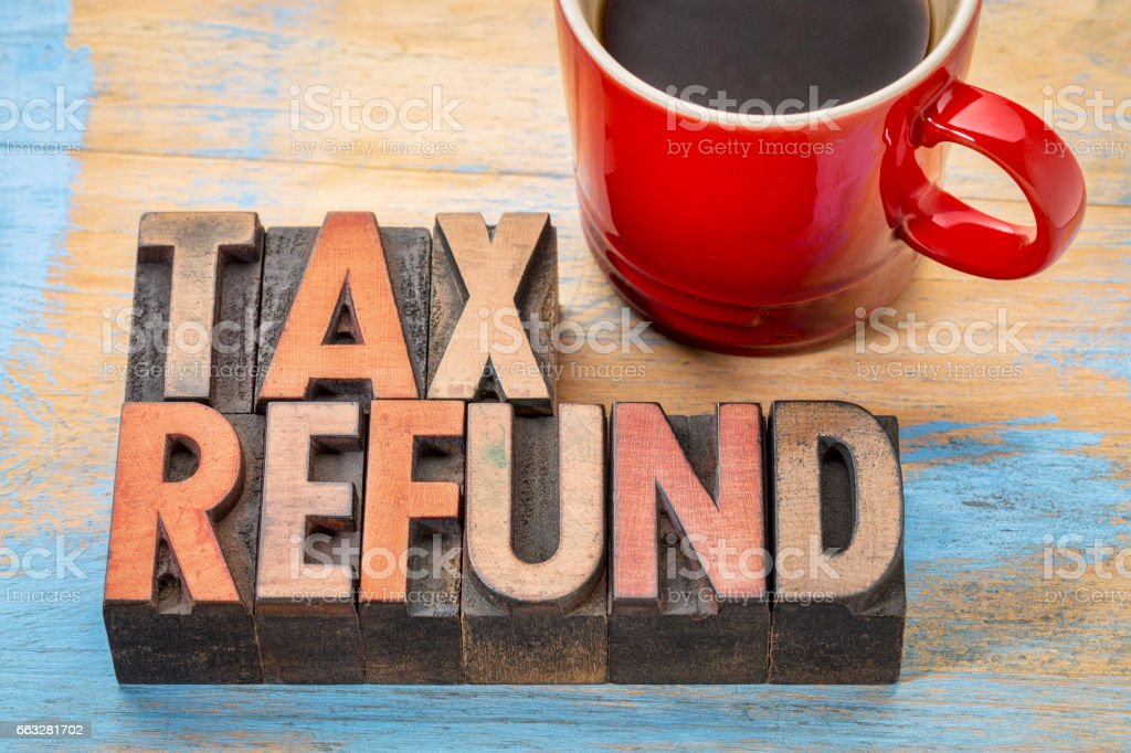 tax refund in wood type stock photo