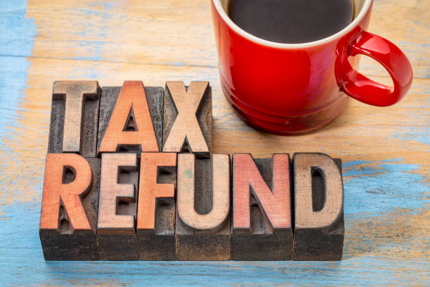 tax refund in wood type tax refund - word abstract in vintage letterpress wood type blocks with a cup of coffee refund stock pictures, royalty-free photos & images