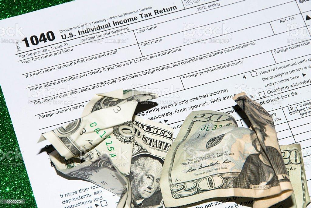 Irs Tax Return Form 1040 And Dollar Bill Stock Photo Istock