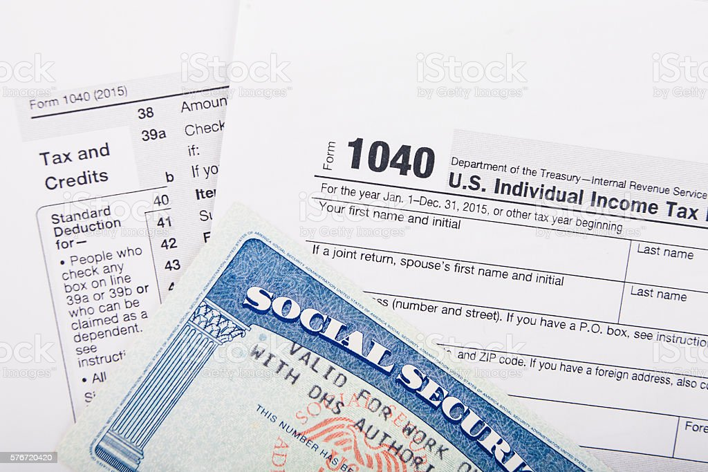 Tax return form and SSN card stock photo