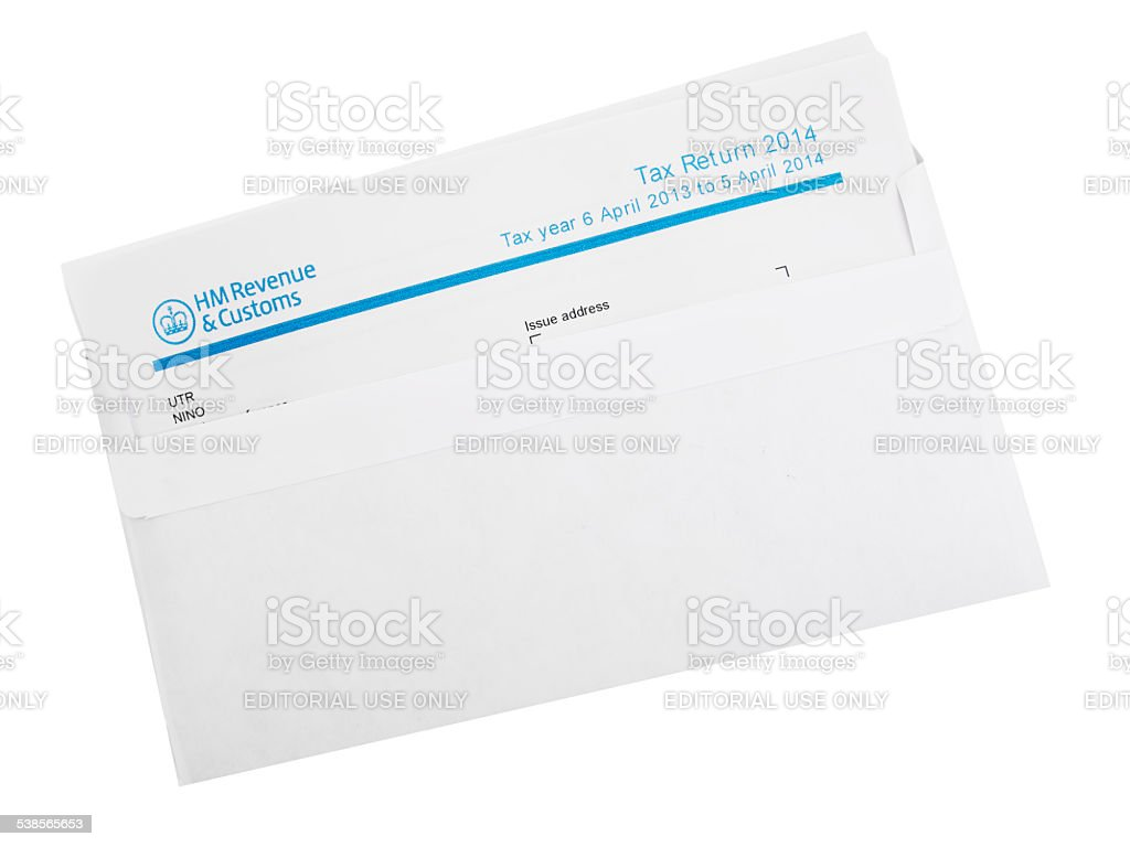 UK tax return in envelope isolated on white. stock photo