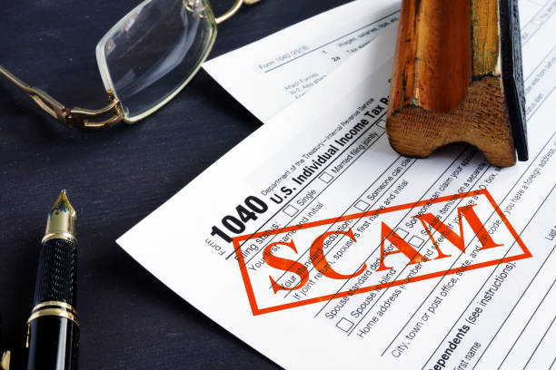 IRS tax scam. 1040 form and red stamp. stock photo