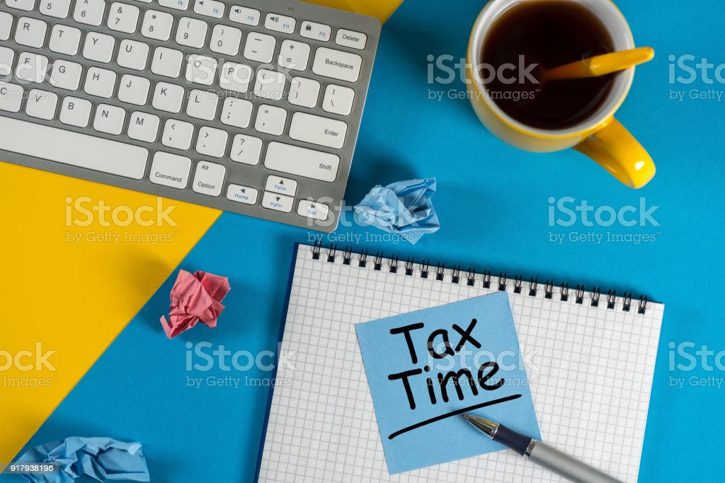 Tax Time - accauntant or businessman workplace with notification of the need to file tax returns, tax form stock photo
