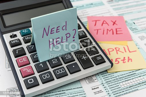 184625018 istock photo Tax time on sticker wit calculator on tax form 1221634590