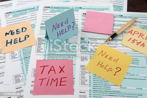 184625018 istock photo Tax time on sticker wit calculator on tax form 1225538280