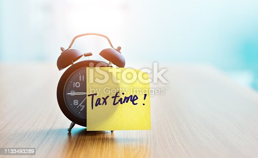 istock Tax Time sticky note on alarm clock. 1133493289