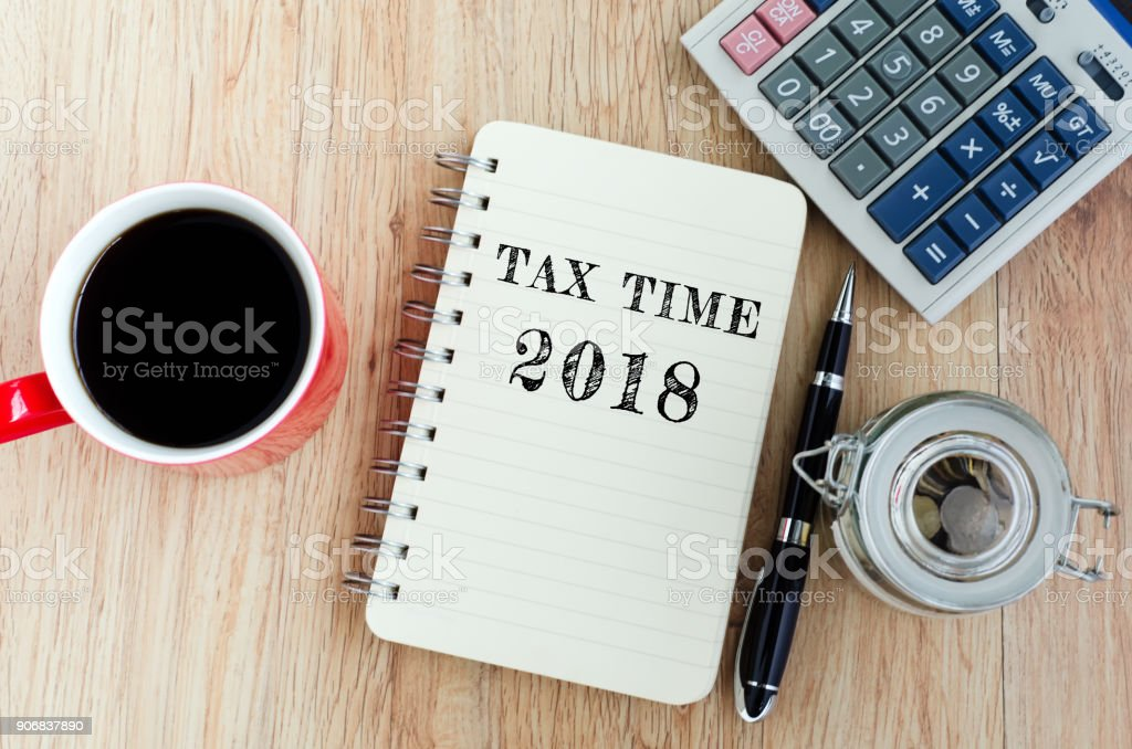 Tax Time Text on Notepad stock photo
