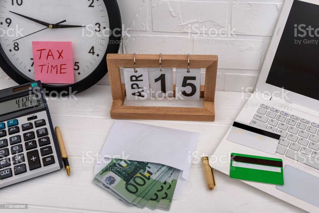 Tax Time With Clock Laptop And Euro Banknotes Stock Photo Download Image Now Istock