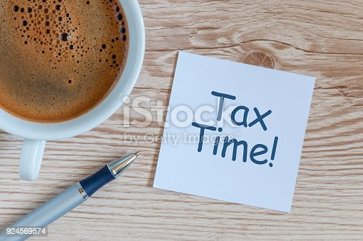 istock Tax time. Workplace with morning coffee cup, and notification about taxes 924569574