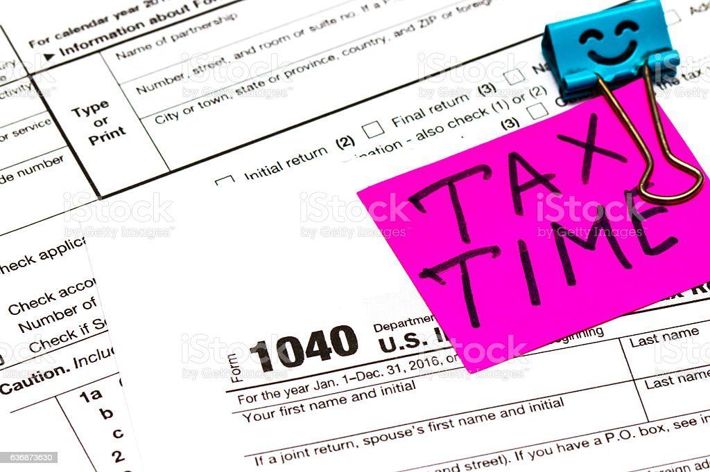 Tax time written on a bright sticker note paper clip stock photo