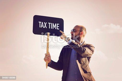 istock Tax time written on small blackboard. 946618696
