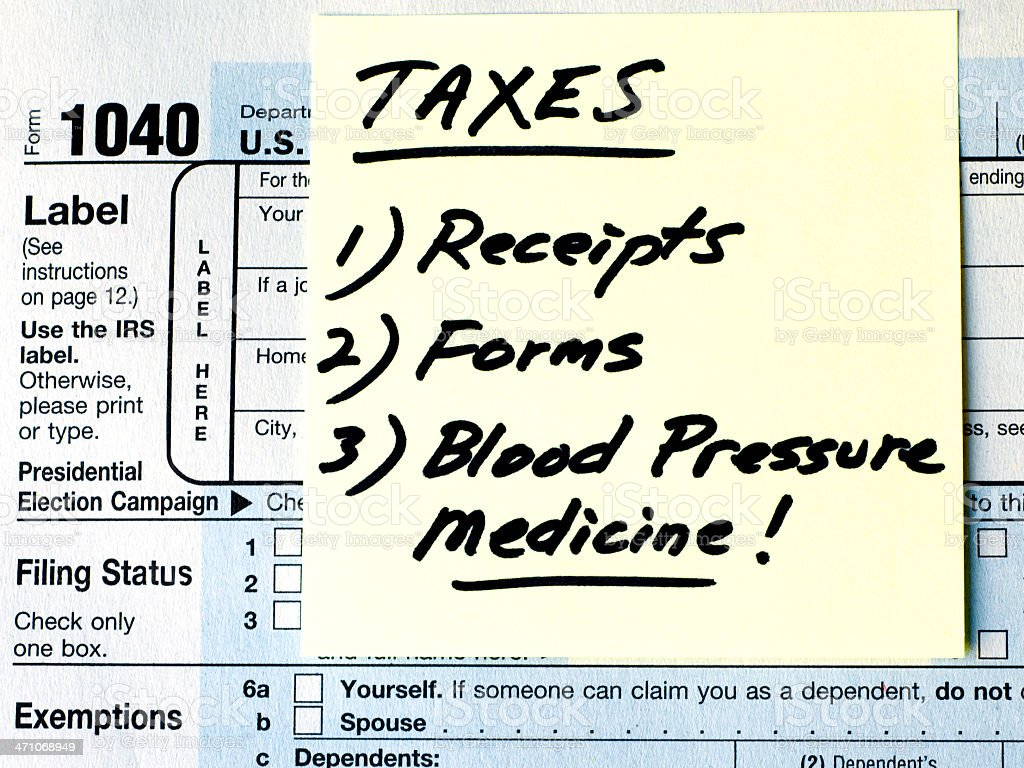 Tax To-Do List Series - Receipts, Forms, Blood Pressure Medicine royalty-free stock photo