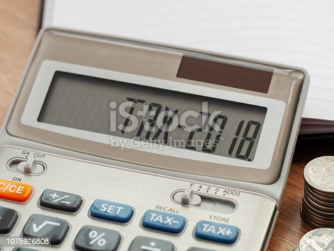 1185240988 istock photo Tax word and 2018 number on calculator. Business and tax concept. Pay tax in 2018 years. 1075926808