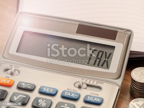 1185240988 istock photo Tax word on calculator. Business and finance tax concept for yearly tax time. 1136634036