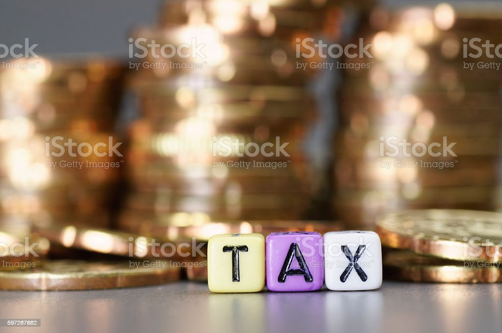 Tax word on dices royalty-free stock photo