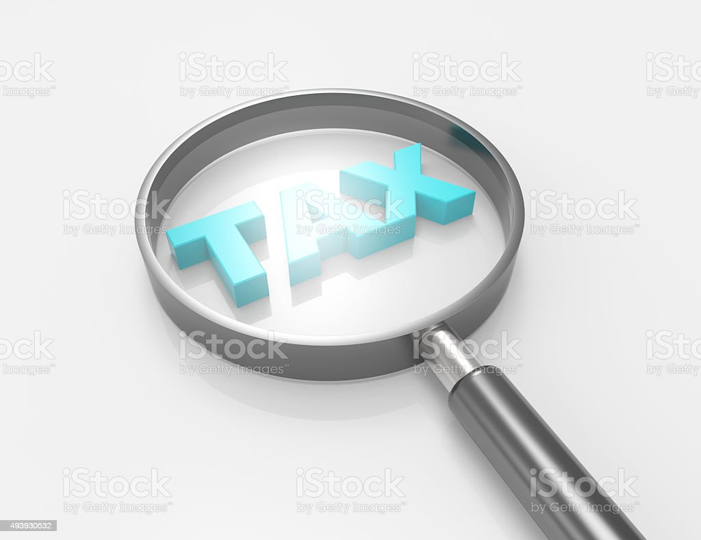 tax word with magnifyingglass stock photo