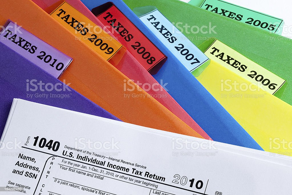 Taxes and Folders stock photo