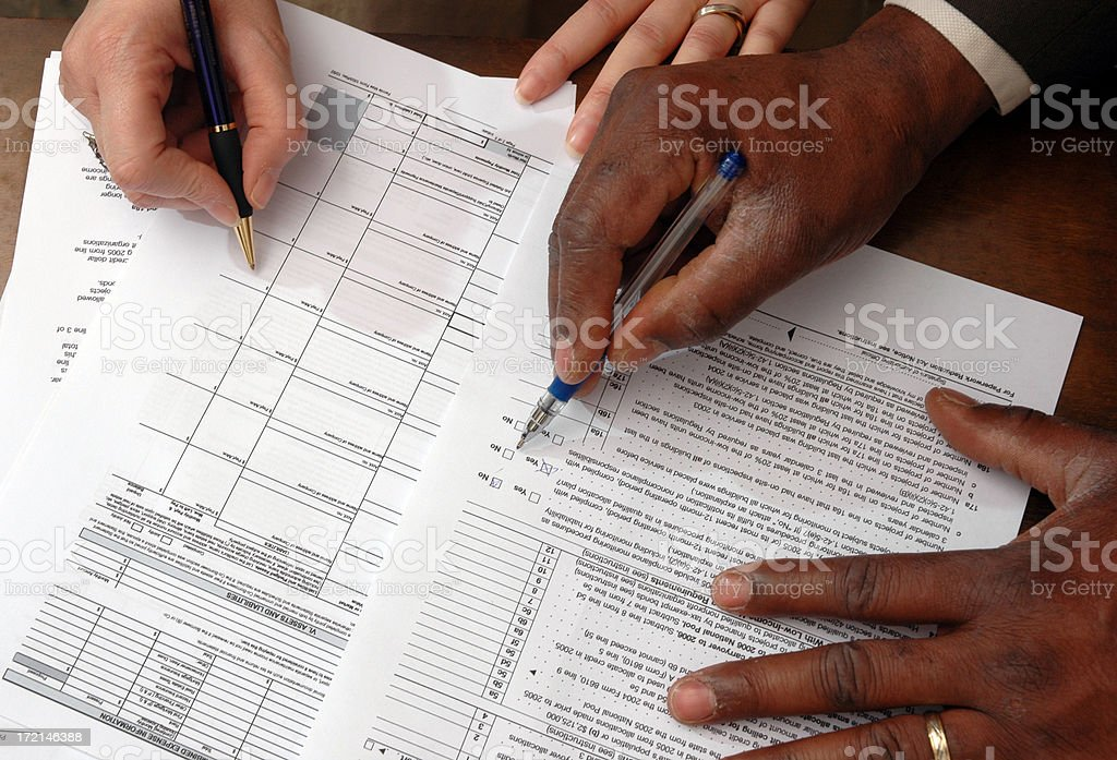 Taxes and paperwork stock photo