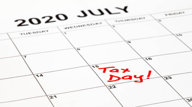 Taxes due date is set for 15th July 2020 due to corona virus outbreak. Calendar page with Tax Day written in red, remainder to pay taxes. Filling and payment was extended by the government. Taxes due date is set for 15th July 2020 due to corona virus outbreak. Calendar page with Tax Day written in red, remainder to pay taxes. Filling and payment was extended by the government. taxes stock pictures, royalty-free photos & images