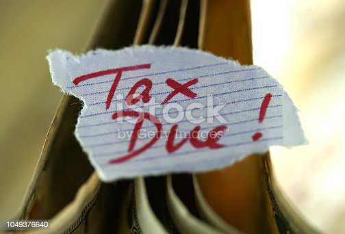shot of tax due sign
