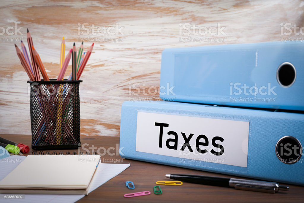 Taxes, Office Binder on Wooden Desk stock photo